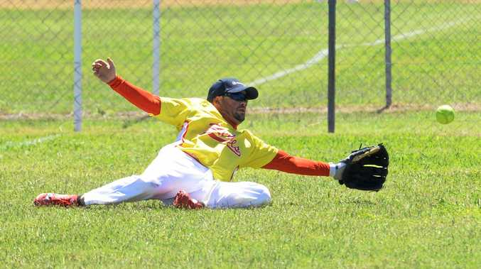 Rebels softballer Chase Cunningham makes a desperate grab for the ball during Switch Moneyball softball tournament played in Ipswich over the weekend.