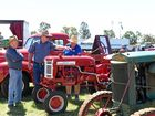 Patrons inspect one of the many tractors on display at the Historic Commercial Vehicle show.