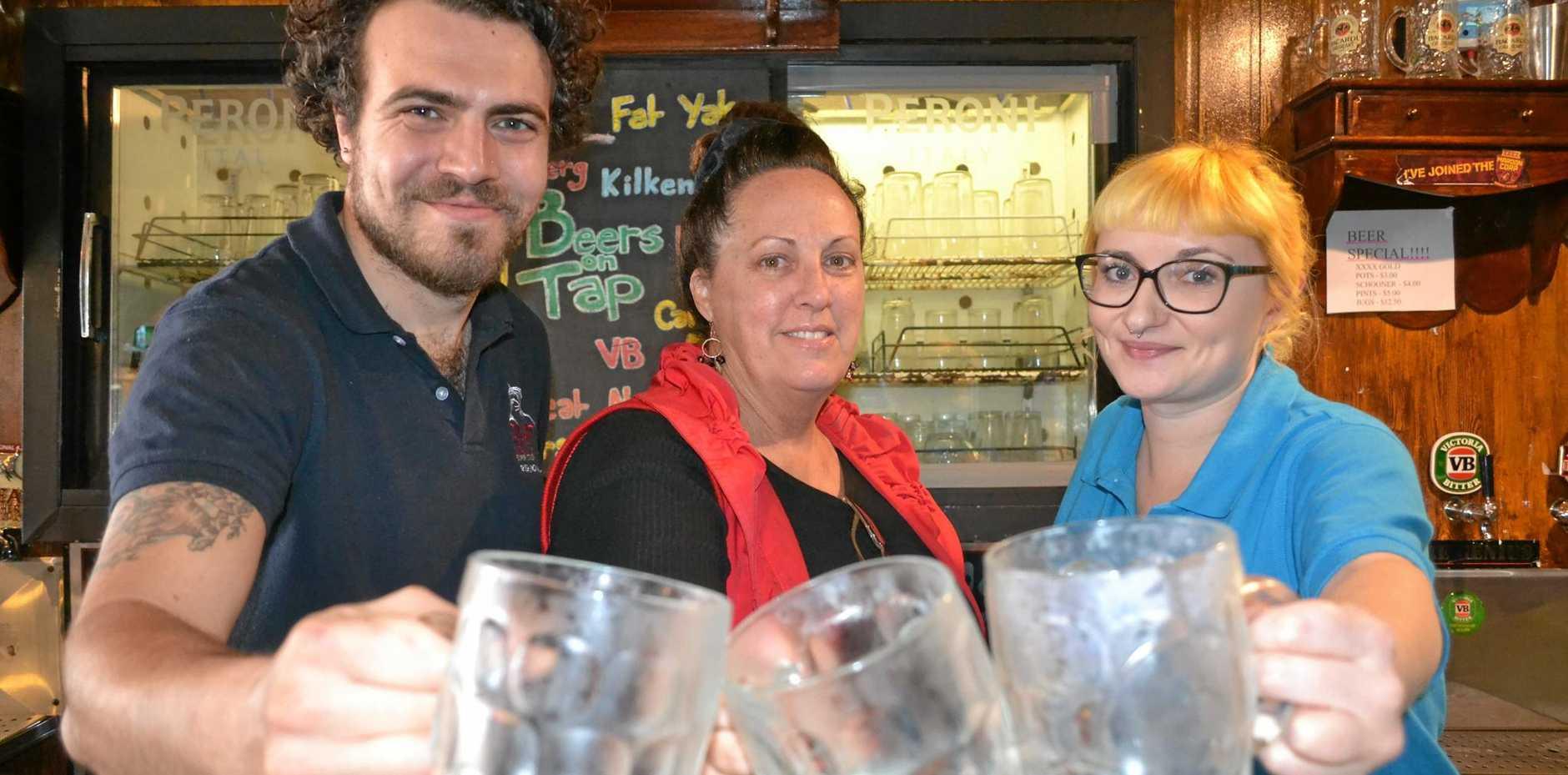 CHEERS: Irish's new manager Amanda McKinnon with employees Dan and Jenny.