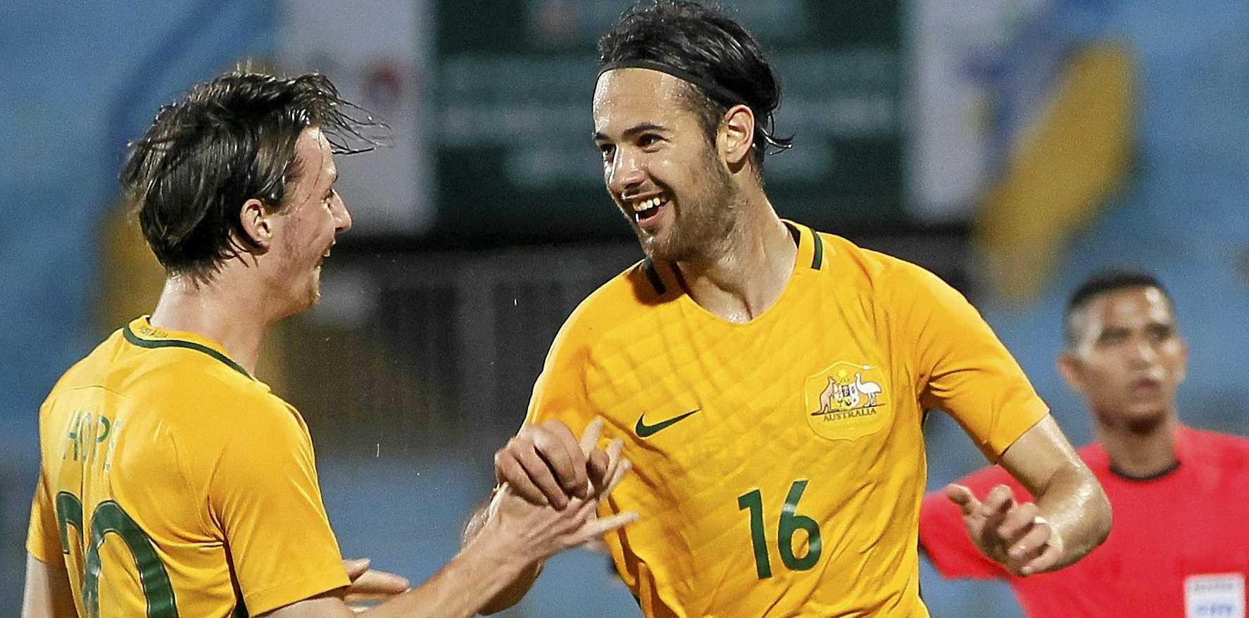 Australian player Steve Kuzmanovski (left) celebrates with Joshua Andrew Hope after scoring against Thailand in Hanoi.