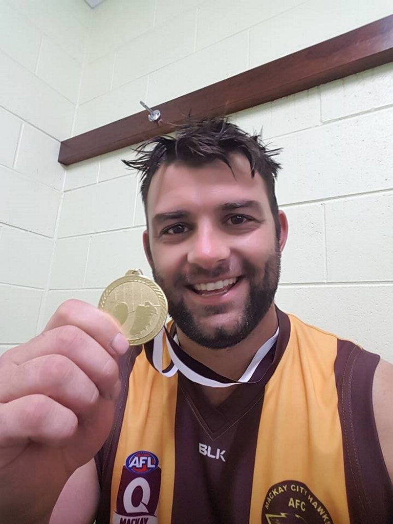 Nick Morton posted this photo on his Facebook page after being awarded his premiership medal but doesn't remember it.