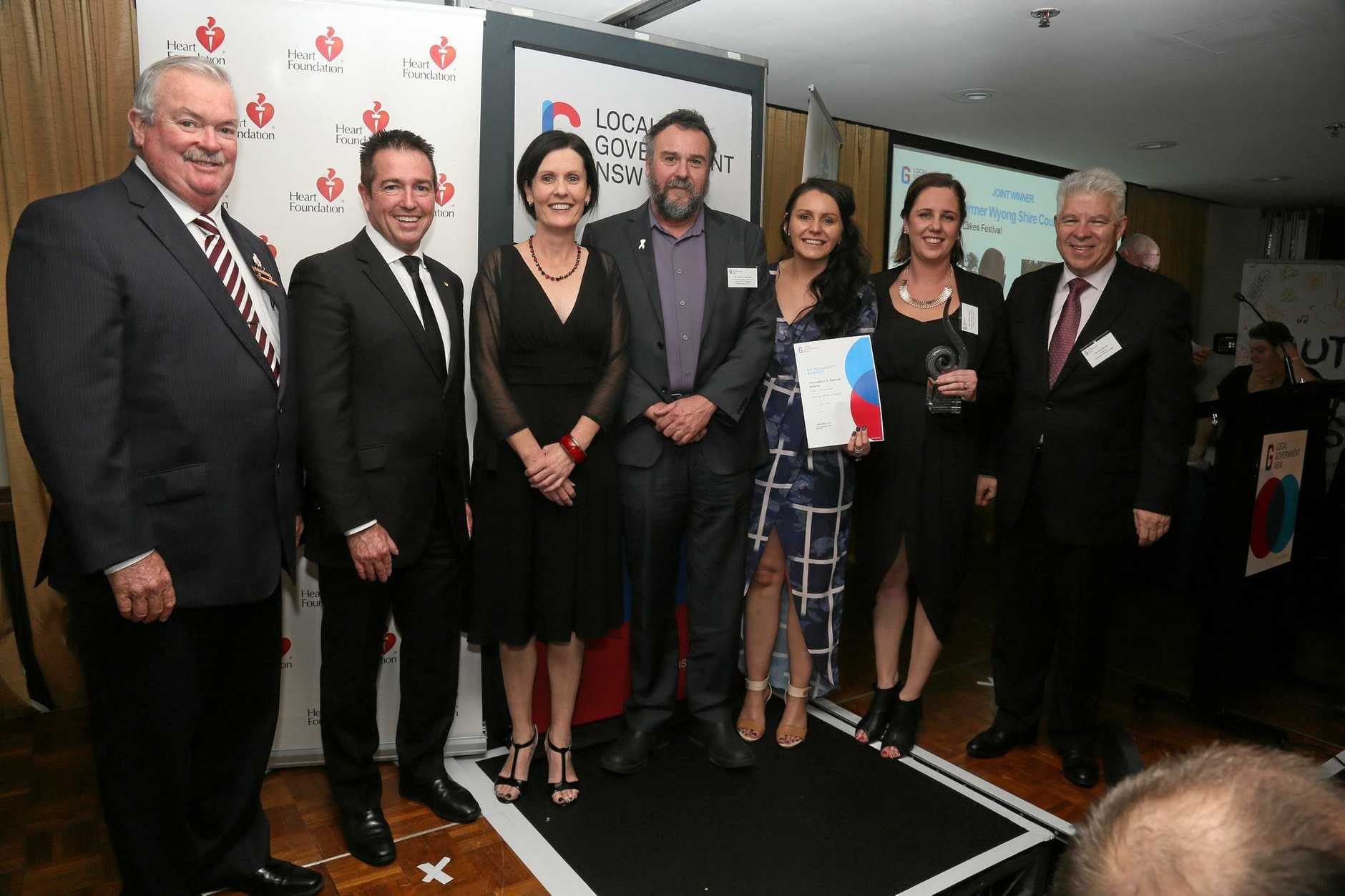 Council's Julie Vaughan (third from left) receives the coveted award for Tuggerah Lakes festival