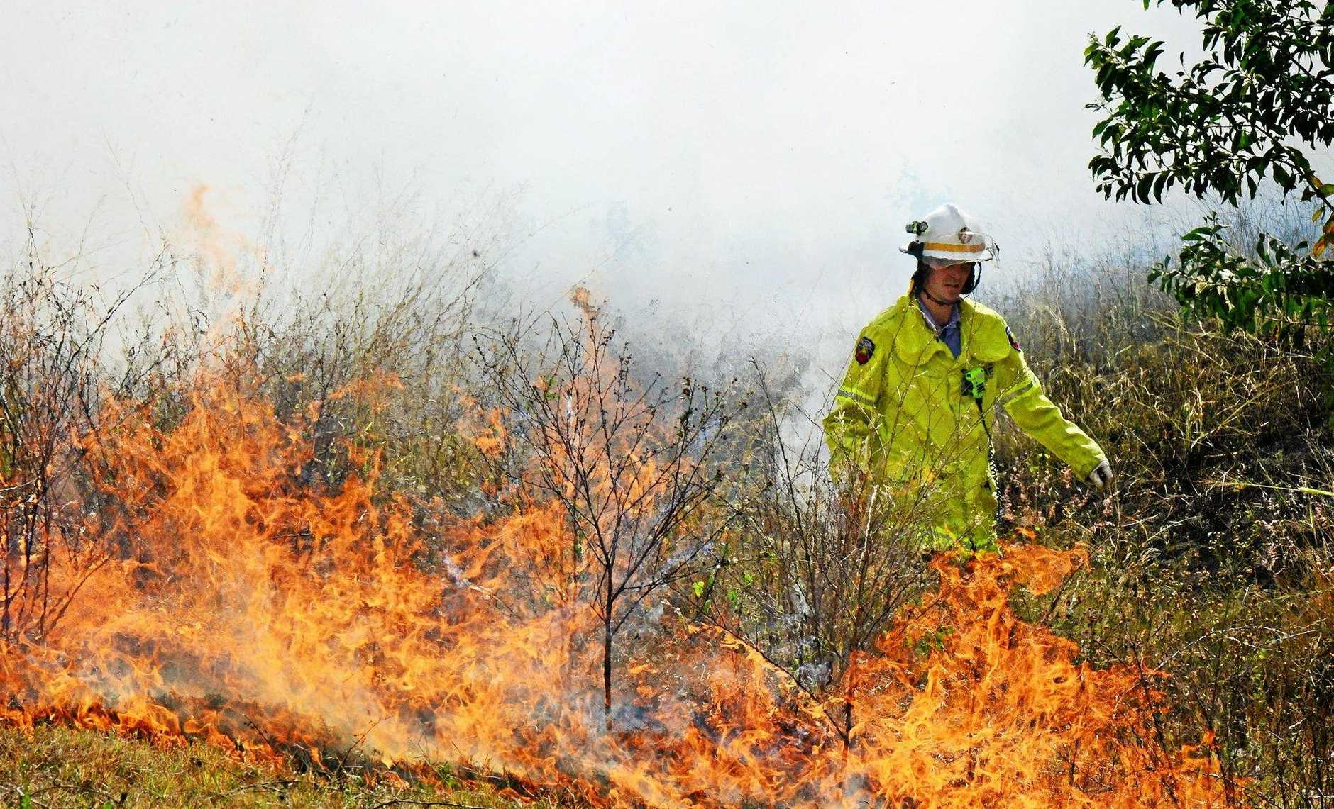 Queensland Fire and Rescue Services fire fighters from the Ripley Station were on hand to control a small grass fire at Yamanto. Photo: David Nielsen / The Queensland Times