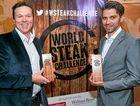 WINNER DINNER: Jacks Creek's Patrick Warmoll and importer Frank Albersdisplay their World Steak Challenge winners trophies.