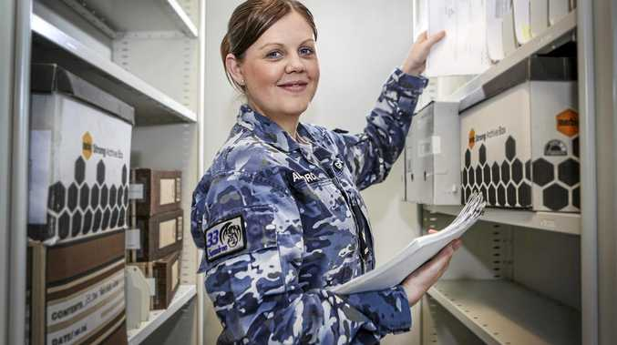 Corporal Hayley Geisler, Reservist Liaison Officer for No. 33 Squadron, at work at RAAF Base Amberley.