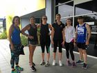 KICKING THE KILOS: Sunshine Coast Daily staff jumped on the chance to wear comfy activewear to work.