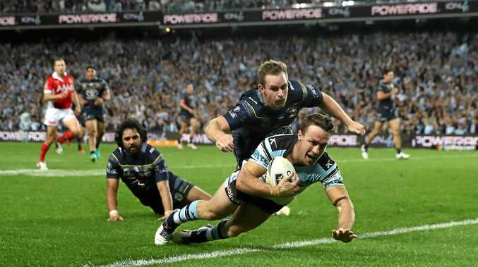 DANGER MAN: Cronulla's James Maloney scores a try during last weekend's preliminary final against the Cowboys at Allianz Stadium.