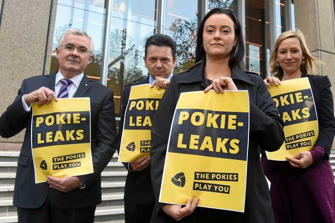 SEEKING REFORM: Problem gambler Shonica Guy, foreground, with Andrew Wilkie, Nick Xenophon and Larissa Waters.