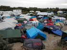 View of the makeshift camp in Calais, northern France, Monday, Sept. 26, 2016. The migrant camp in Calais must be fully dismantled by the end of the year, French President Francois Hollande said Monday in an attempt to highlight the Socialist government's efforts to tackle the issue ahead of next year's presidential election. (AP Photo/Thibault Camus)