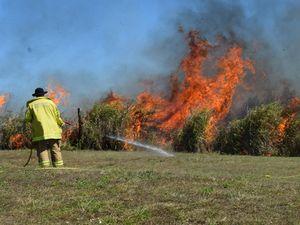 Residents 'nervous' as grass fire burns near homes