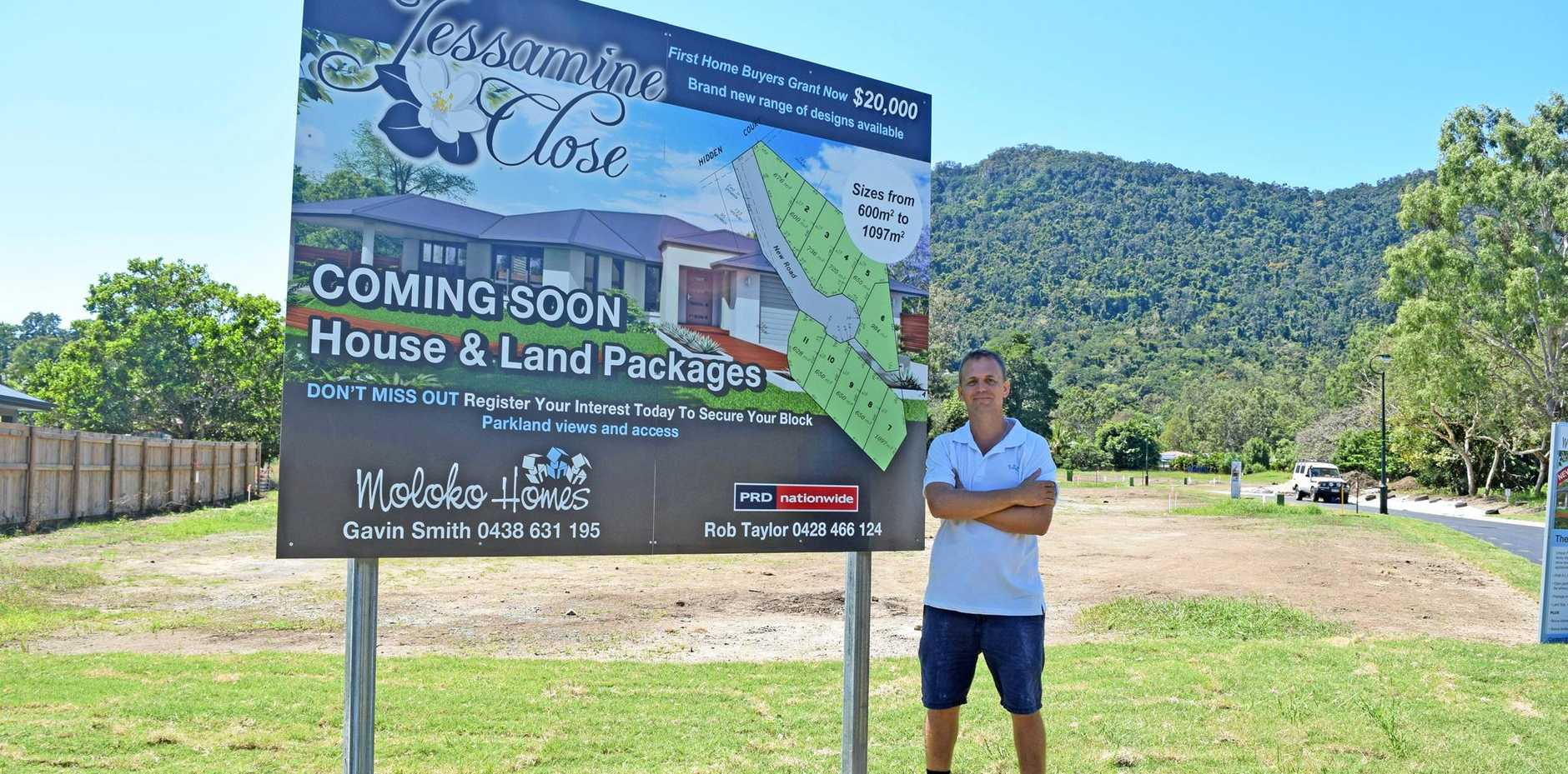 BEAUTIFUL VISTA: Gavin Smith standing on the land where 11 lots will be developed at Whitsunday Lakes.