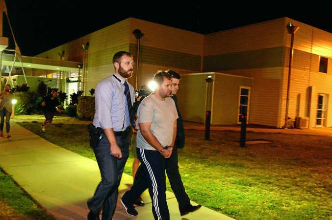 Jason Wayne Greatbatch, 36, from South Australia, arrives at Mackay airport with detectives. He is charged with attempted murder, stalking and assault over alleged attacks on two Mackay region residents including young mum Teagan Moore.