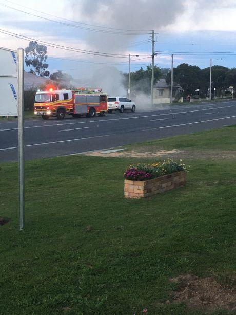 Car on fire near on Wood St near Short St in Warwick.