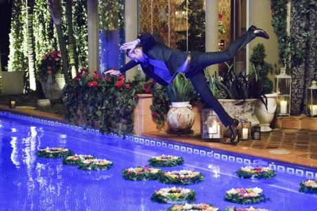 Clancy Ryan jumps in the pool during the cocktail party in a scene from The Bachelorette.