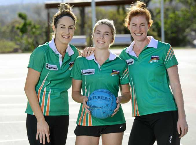 Ipswich Flyers netballers Nicole Grant, Bridget Cumming and co-captain Liz Hales relax before Friday night's SEQ Challenge grand final.