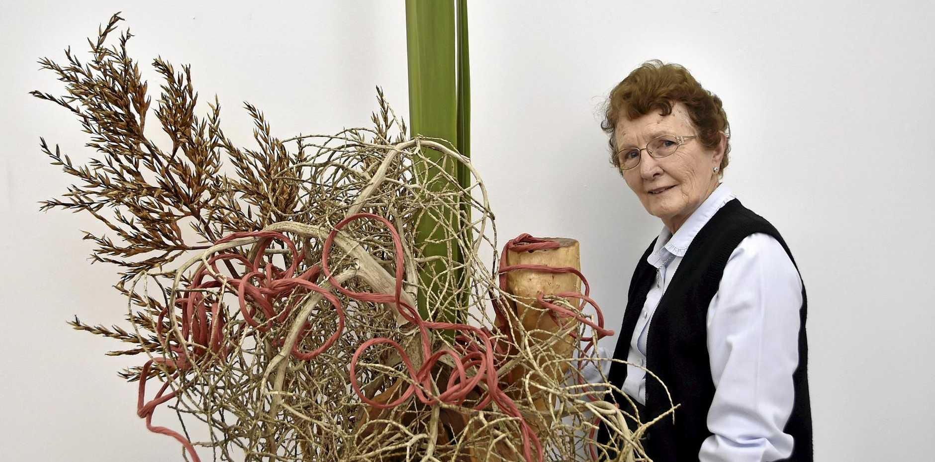 Dorothy Herrmann spends an afternoon at TRAG. The art gallery is decorated for the Canrival of Flowers with work by members of the Toowoomba Ikebana Group.