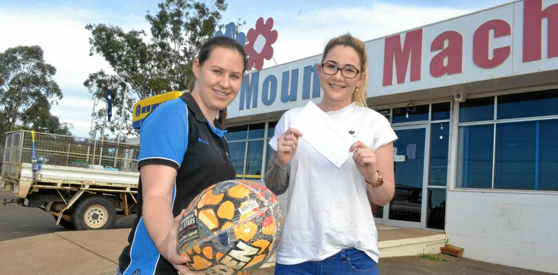 TOP TIP: The winner of The Western Star's NRL Footy Tipping Competition is Mounts Machinery's Rhonda Dolgner. She's pictured here with advertising rep Tori Johnson.