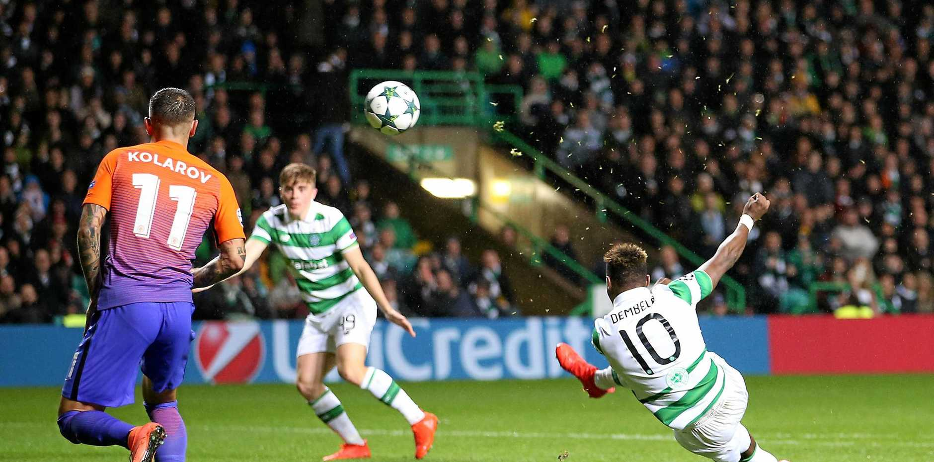 Celtic's Moussa Dembele cores his side's third goal during the Champions League Group C soccer match against Manchester City at Celtic Park in Glasgow.