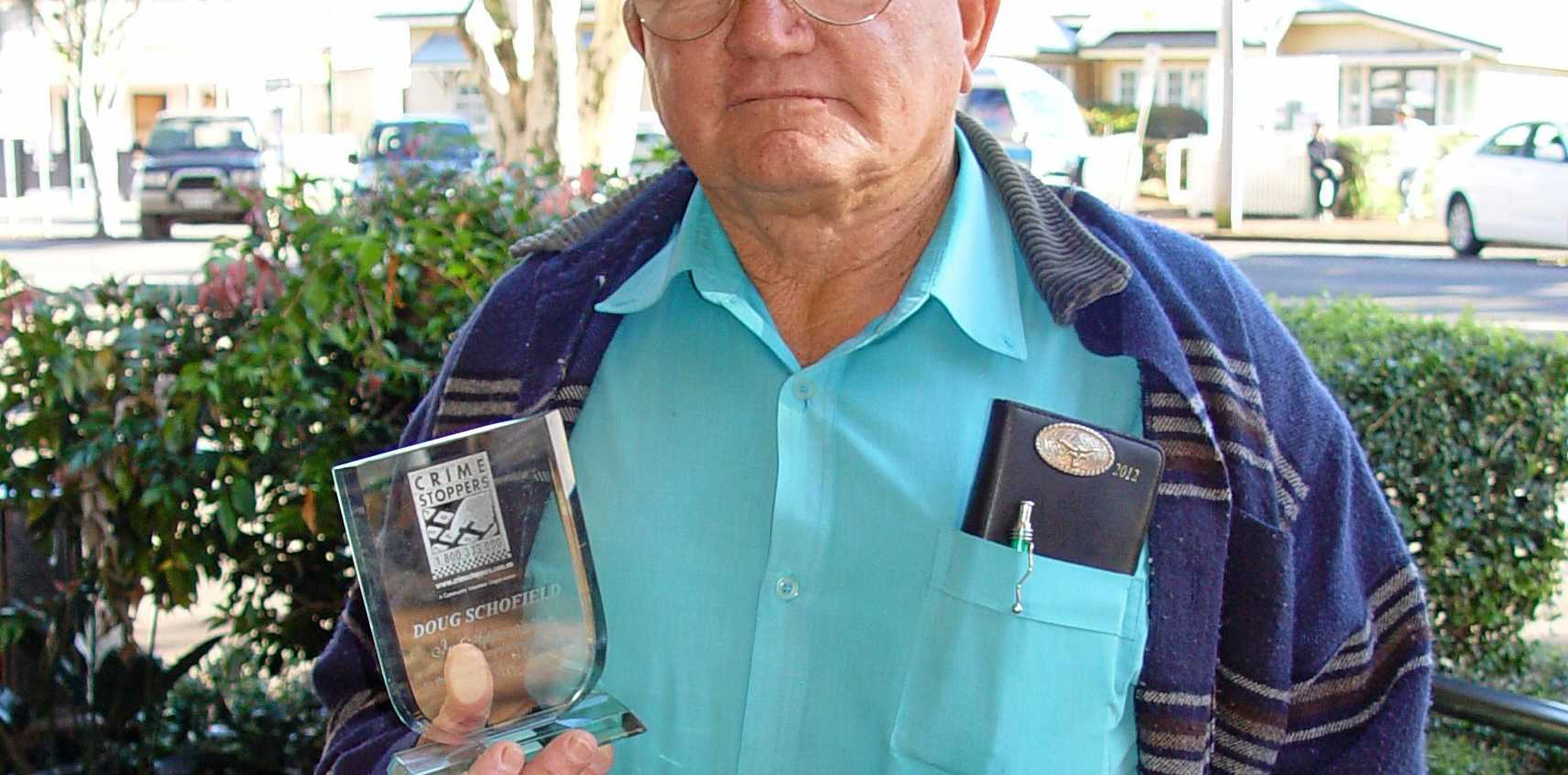 HONOUR: The late Doug Schofield, with a trophy recognising his fundraising for Bundaberg Region Crime Stoppers Committee, is being honoured by the council.