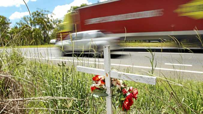 A roadside memorial on the Warrego Highway near the Haigslea-Amberley Rd intersection.
