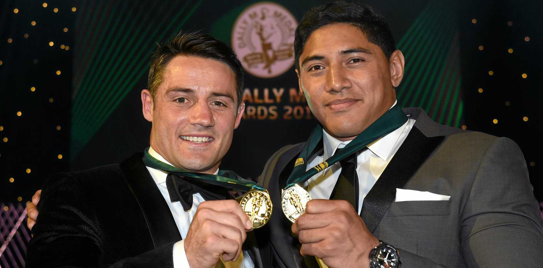 Melbourne's Cooper Cronk and North Queensland's Jason Taumalolo with their Dally M Medals.