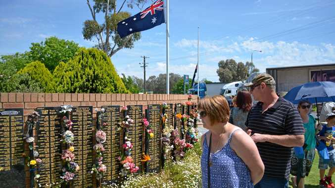 People checkout the Tarcutta Truck Drivers Memorial Wall on the memorial day.