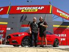 TOP PRIZE: A Prodrive Racing-modified Ford Mustang GT was won by Mark Trembath of Mountain Creek (left) as part of a Supercheap Auto and Castrol promotion. The prize was given to Mark at Supercheap Kawana by Supercars driver Chaz Mostert (right).