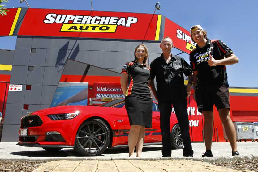 A Prodrive Racing-modified Ford Mustang GT was won by Mark Trembath of Mountain Creek (centre) as part of a Supercheap Auto and Castrol promotion. The prize was given to Mark at Supercheap Kawana by Supercars driver Chaz Mostert (right) and Supercheap's Janet Bulloch.Photo: Iain Curry