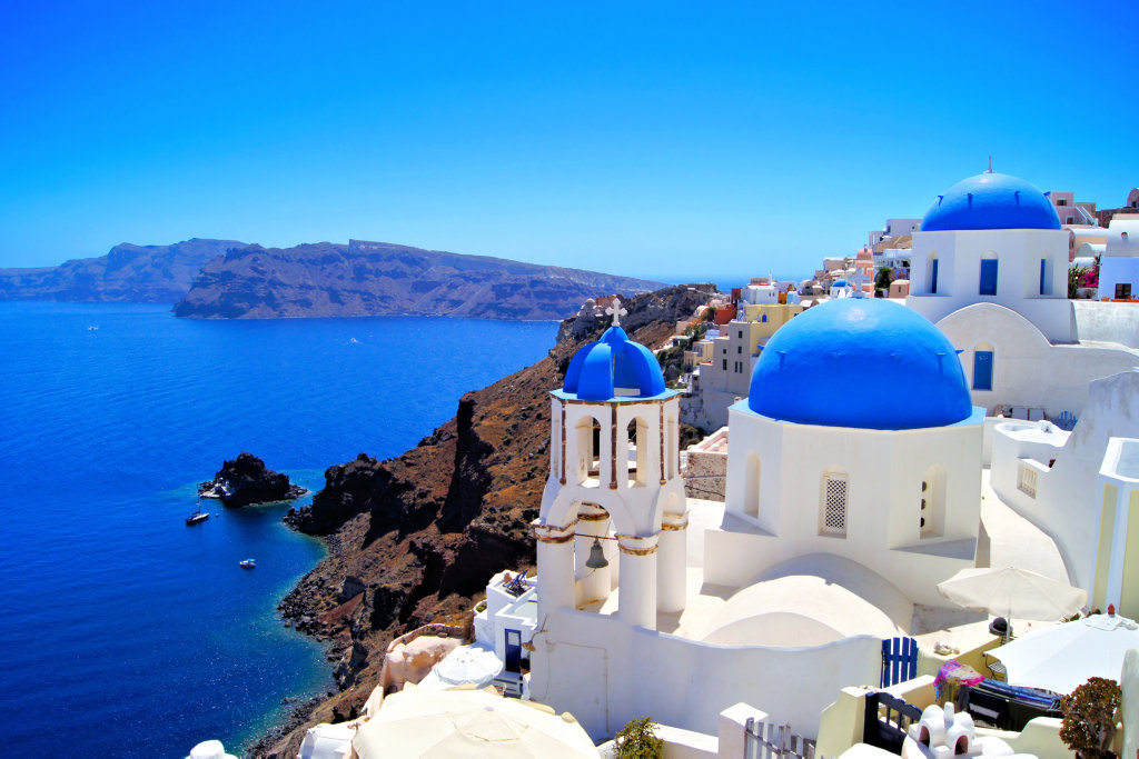 The breathtaking views and stunning blue domes for which Santorini is known.