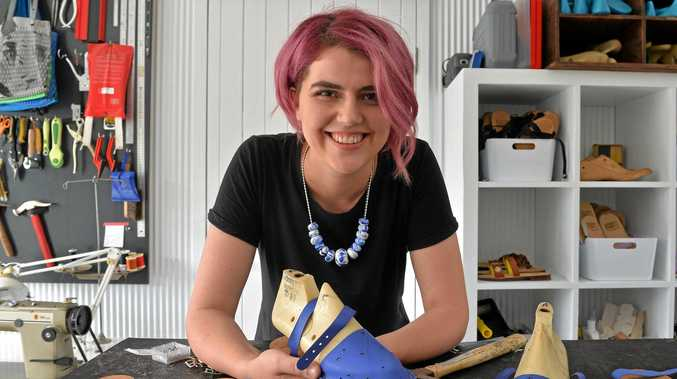 BEST FOOT FORWARD: Local Sunshine Coast designer Felicity Cooney shows off her latest pair of sandals