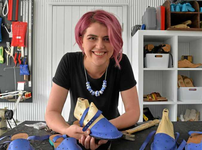 BEST FOOT FORWARD: Local Sunshine Coast designer Felicity Cooney shows off her latest pair of sandals