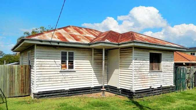 RENOVATOR'S DREAM: This Dinmore property will go under the hammer in October.