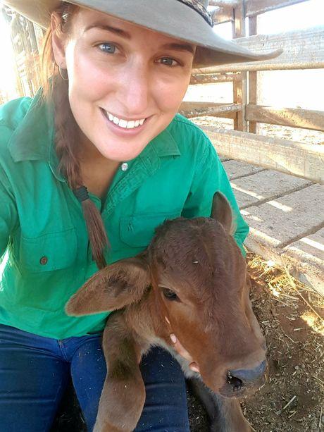 Jillaroo Jess with 'Brittany' the poddy calf.