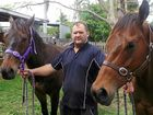Rockhampton trainer Tim Cook with Zaha Express on the right.