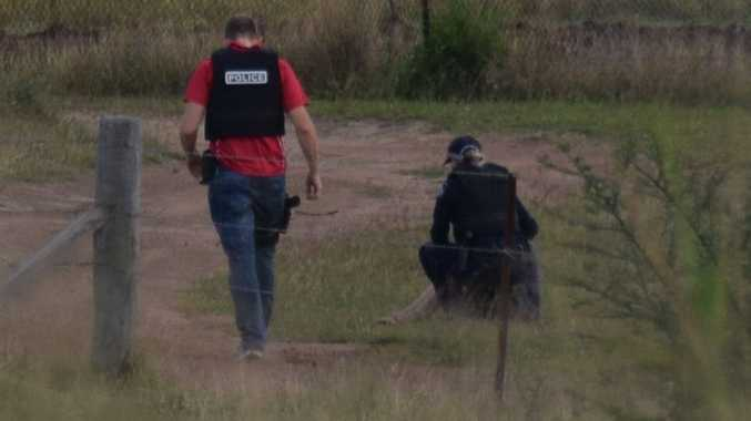 Police speak to the man who allegedly fired four shots at a Kabra property.