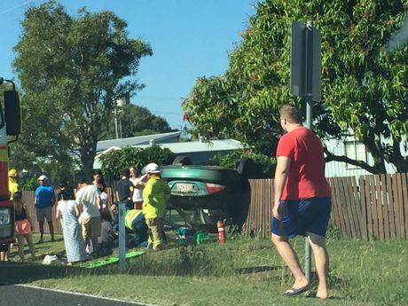 UPSIDE DOWN: A car has rolled at the intersection of Elliott Heads Rd and Saunders St, Elliott Heads.
