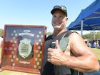 The heavy weight and overall champion Liam Hackett with his trophy after competing in the annual Australian Goanna Pulling Championships at Wooli sports grounds on Sunday 2nd October, 2016.