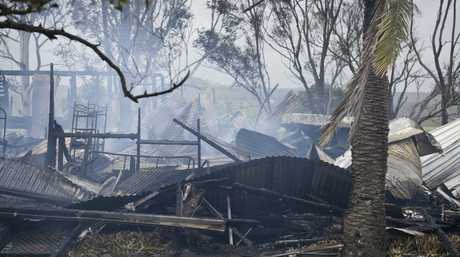 The destroyed home was still smouldering this morning when fire investigators returned to the scene.