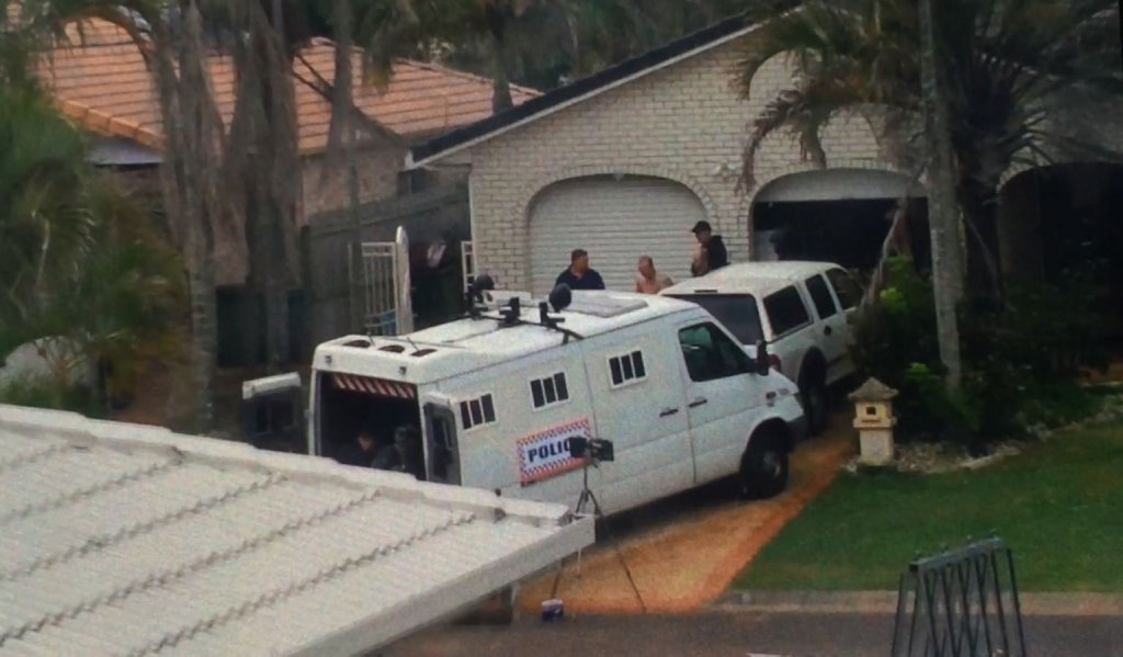 Police arrest a shirtless man after a stand-off at a Seafarer Ct home in Bokarina.