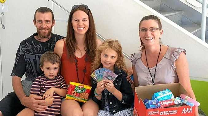 SUPPORTIVE: Halo Love and family at Impact Community Services with the supplies she donated for the homeless.
