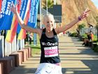 Brisbane's Clare Geraghty celebrates back-to-back wins in the women's half marathon at the running festival.