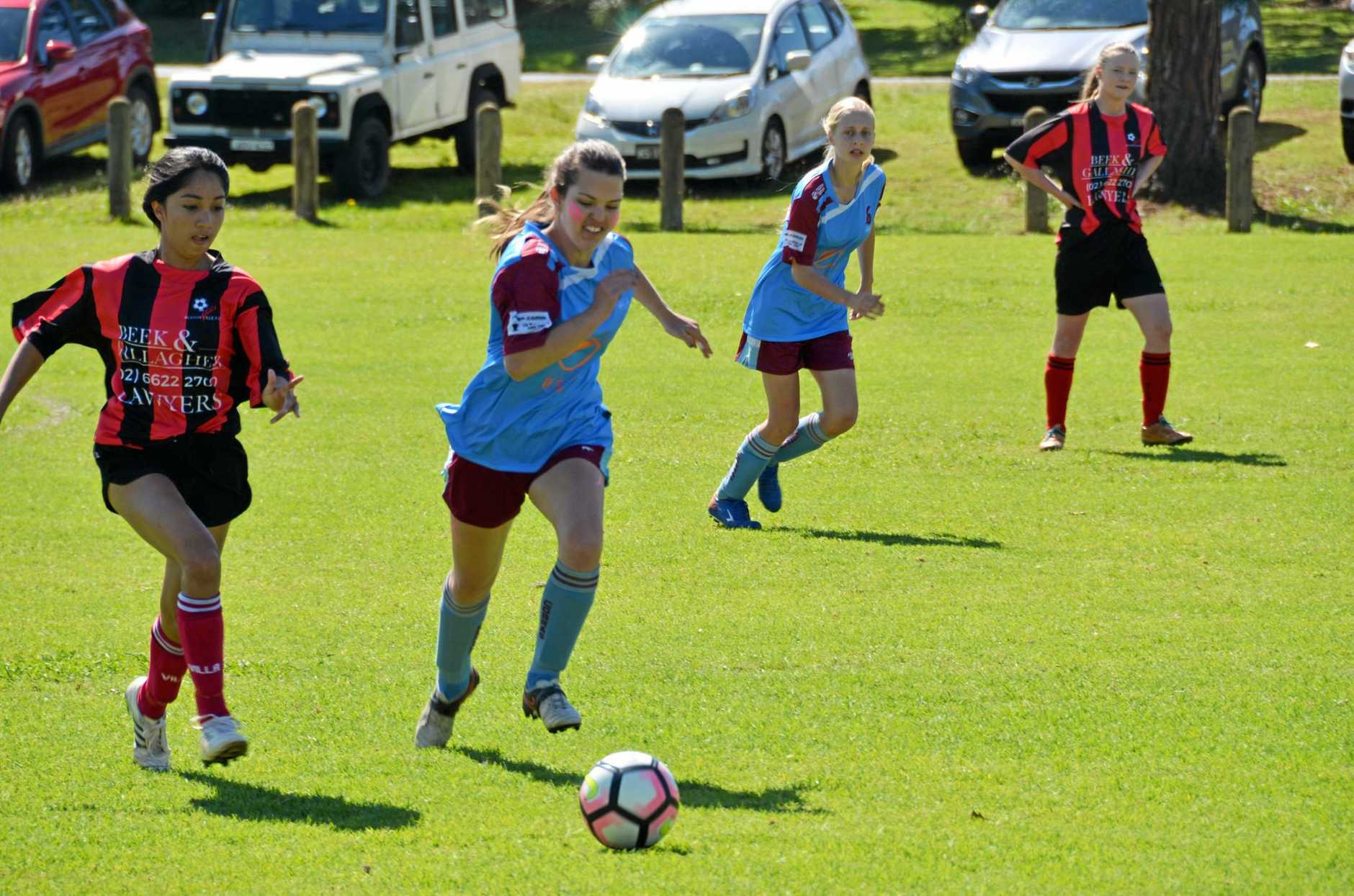 U16's Mia Casagrande from the Alstonville Strikers and Isabella Carey from the Casino Cobras fight for possession during a Oceania Cup match.