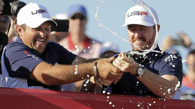 Patrick Reed Jimmy Walker spray fans with champagne after the United States team won the Ryder Cup.