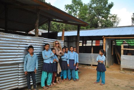Hanging out with young students in Satyadevi Dhading in Nepal is Toowoomba's Moyalia Tokmak.