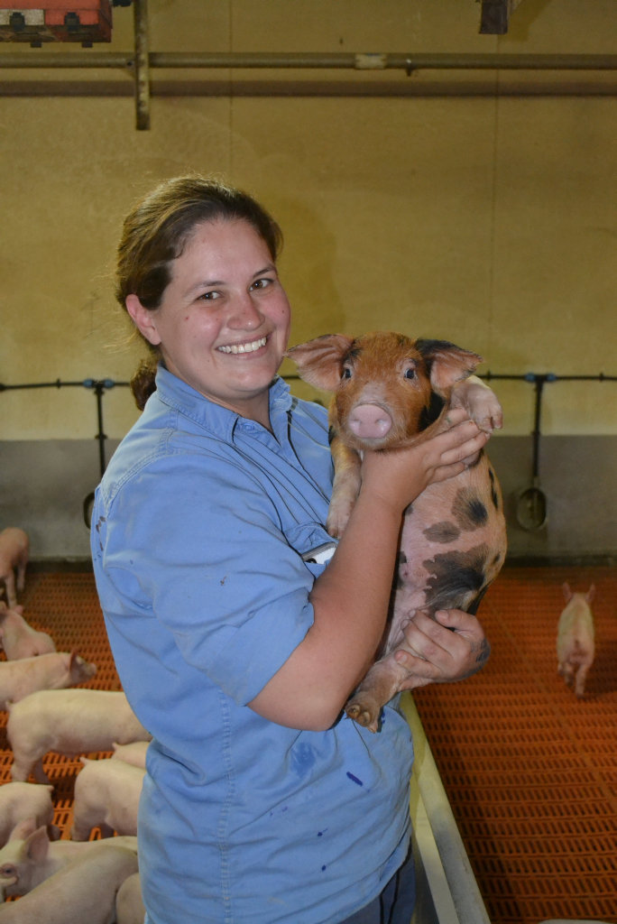 A staff member with one of the farm's pigs.Photo Contributed