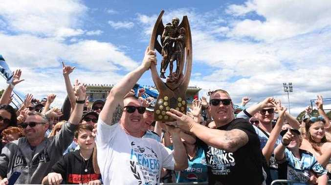 Cronulla Sharks captain Paul Gallen and forward Luke Lewis hold up the trophy at a fan day at Southern Cross Group Stadium, after they defeated the Melbourne Storm in the 2016 NRL Grand Final in Sydney, Monday, Oct. 3, 2016.