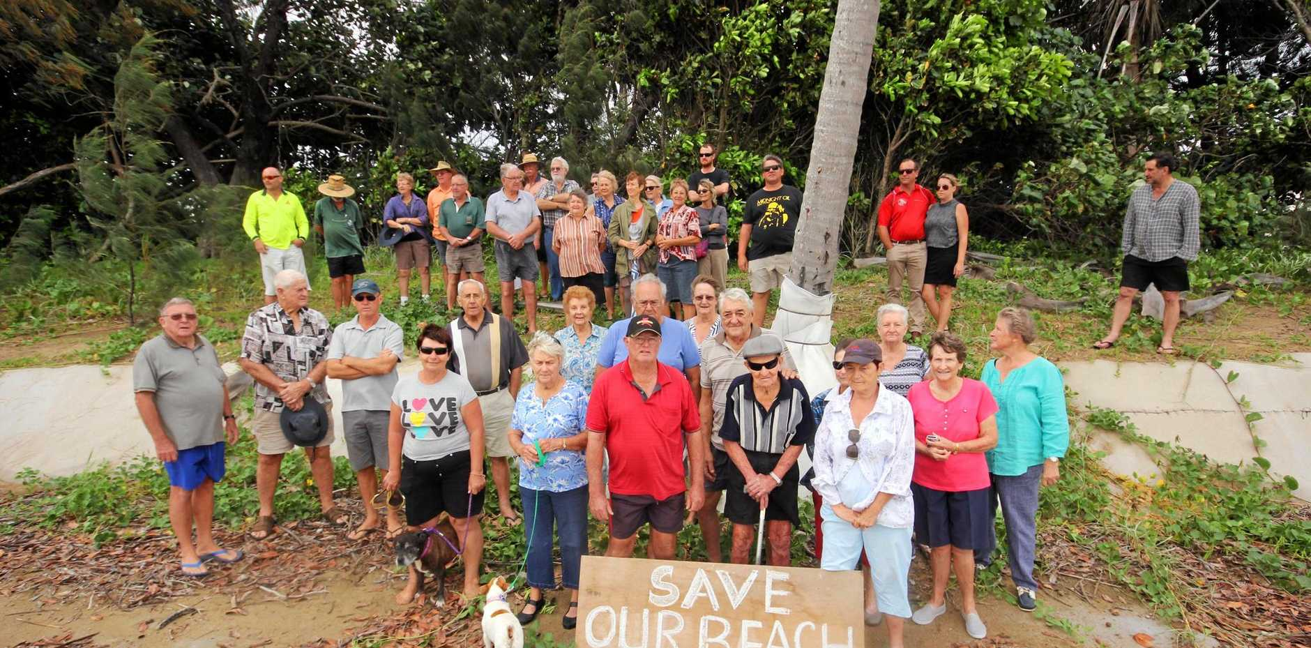 NOT HAPPY: Members of the Midge Point Progress Association on their beach in protest on Tuesday.