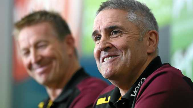 Brisbane Lions football boss David Noble (left) and coach Chris Fagan smile during a press conference at the Gabba.