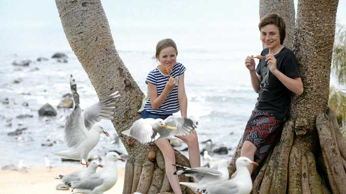 FAMILY FUN: New South Wales visitors Laney and Rory Unsworth enjoying their holiday at Bargara yesterday.