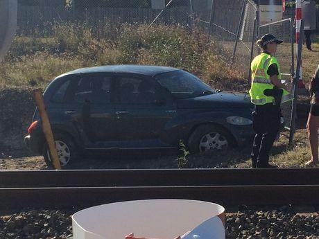 Car stuck on rail line.